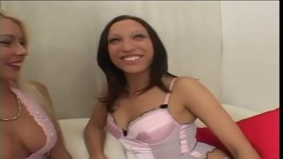Sexy blonde and brunette lesbian duo fuck with a dildo on the sofa